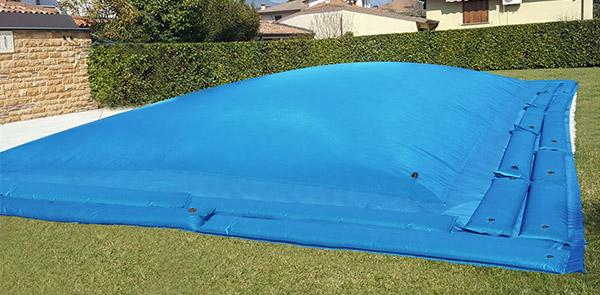 Copertura Invernale di sicurezza per piscina Polartex® AIRCOVER con bretelle porta salsicciotti